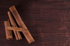 Whole cinnamon sticks on wooden background Stock Photography