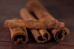 Whole cinnamon sticks on wooden background Royalty Free Stock Photography