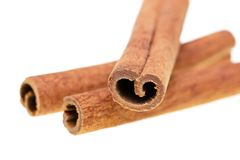 Whole cinnamon on white background stock photography