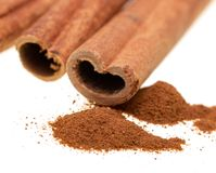 Whole cinnamon on white background royalty free stock photography