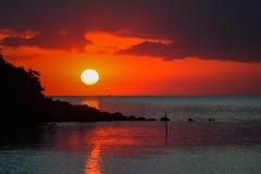 Whole circle sunset at sea. A sea shore at the sunset time with whole circle of the sun Royalty Free Stock Photography