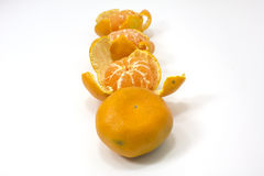 Whole and cleaned tangerines Stock Images