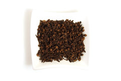 Whole Cloves In Square White Bowl Royalty Free Stock Photos