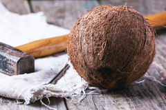 Whole coconut with hammer Stock Photos