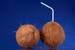 Whole Coconuts with Straw Stock Photo