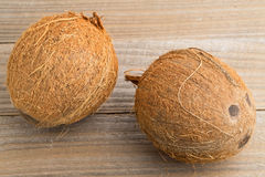 Whole coconuts on table Stock Photo