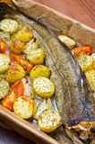 Whole cod with vegetables Stock Photo