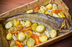 Whole cod with vegetables Stock Images
