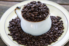 Whole Coffee Beans in a Mug Royalty Free Stock Photo