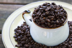 Whole Coffee Beans in a Mug Stock Image