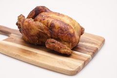 Whole Cooked Chicken. Oven roasted hot chicken on a white background Stock Image