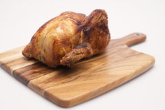 Whole Cooked Chicken. Oven roasted hot chicken on a white background Stock Photography