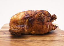 Whole Cooked Chicken. Oven roasted hot chicken on a white background Royalty Free Stock Photo