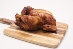 Whole Cooked Chicken. Oven roasted hot chicken on a white background Stock Photos