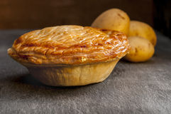 Whole Cooked Pie with Potatoes Stock Photo