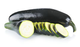 Whole courgettes and cut into slices on white Stock Photos