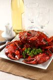 Whole crab in red sauce. On linen Stock Photo
