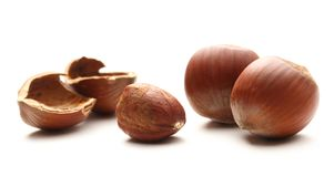 Whole and cracked hazelnuts Royalty Free Stock Images