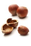 Whole and cracked hazelnuts Stock Images