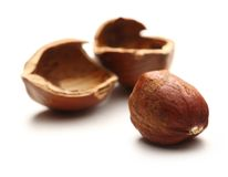 Whole and cracked hazelnuts Stock Photos