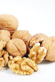 Whole and Cracked Walnuts Royalty Free Stock Photos