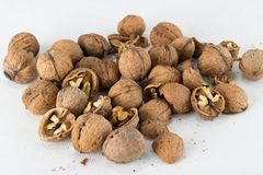 Walnuts on white rough surface Stock Images