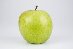 Whole crisp juicy green apple Stock Image