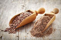 Whole and crushed flax seeds Royalty Free Stock Photo