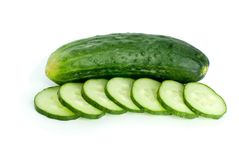 Whole cucumber and few slices. Isolated on the white background Stock Photography