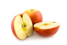 Whole and cut apples. On white Royalty Free Stock Photography