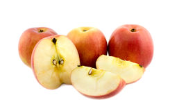 Whole and cut apples. On white background Stock Photography