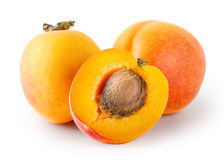 Whole and cut apricots with stones Stock Photo