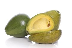 Whole and cut avocados Royalty Free Stock Photos