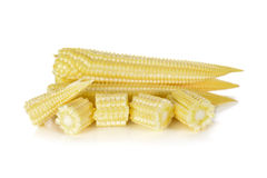 Whole and cut baby corn on white Stock Image