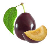 Whole and cut dark plum with leaf isolated on white with clipping path Stock Photo