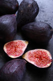 Whole and cut figs Stock Images