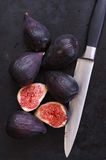 Whole and cut figs Royalty Free Stock Photography
