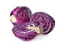 Whole and cut fresh red cabbage on white. Background Stock Images