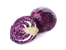 Whole and cut fresh red cabbage on white. Background Stock Image