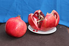 Whole and cut fruit of pomegranate Royalty Free Stock Photos