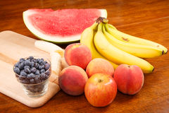 Whole and Cut Fruit on Table Royalty Free Stock Photography