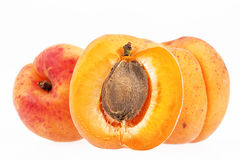 Whole and cut fruits of apricot isolated on white background Stock Photos