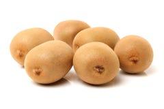 Whole and cut golden kiwifruit/ kiwi (Actinidia chinensis). On white background Royalty Free Stock Image