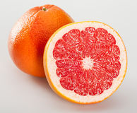 Whole and cut grapefruits Stock Photography