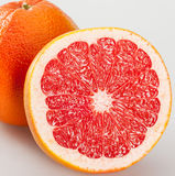 Whole and cut grapefruits Royalty Free Stock Image