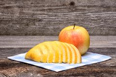 Whole and Cut in Half Apple Royalty Free Stock Photo