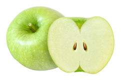 Whole and cut in half green apple isolated on white with clipping path Stock Photos