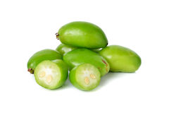 Whole and cut Madan, Garcina tropical fruit on white. Background Stock Photo