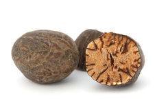 Whole and cut nutmeg closeup Stock Photos