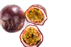 Whole and cut passion fruit on white background. Top view. Whole and cut passion fruit on white background. Passion fruit seeds and pulp. Top view. Close up stock images